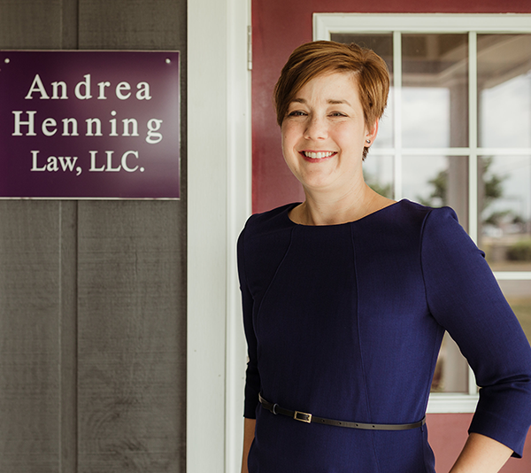 Andrea Henning Law LLC - Andrea standing by the door to her Lima, Ohio office