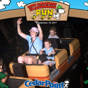 Andrea Henning and children riding a roller coaster